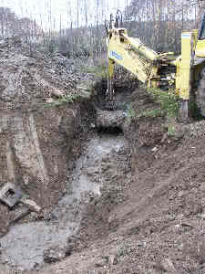 JCB digging drainage trench